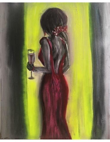 Femme en robe rouge et verre de vin